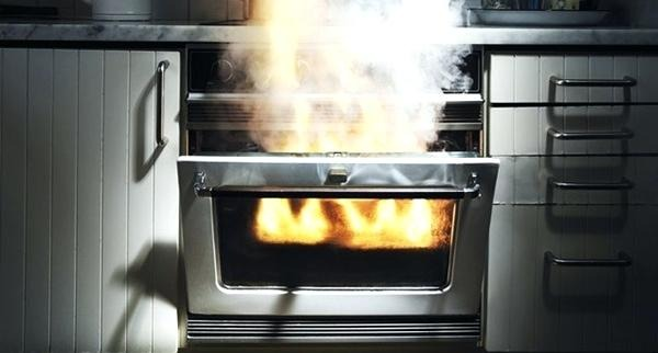 Dirty oven on fire